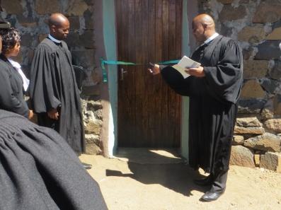 Rev. Masemene cuts the ribbon on the Mashai church building